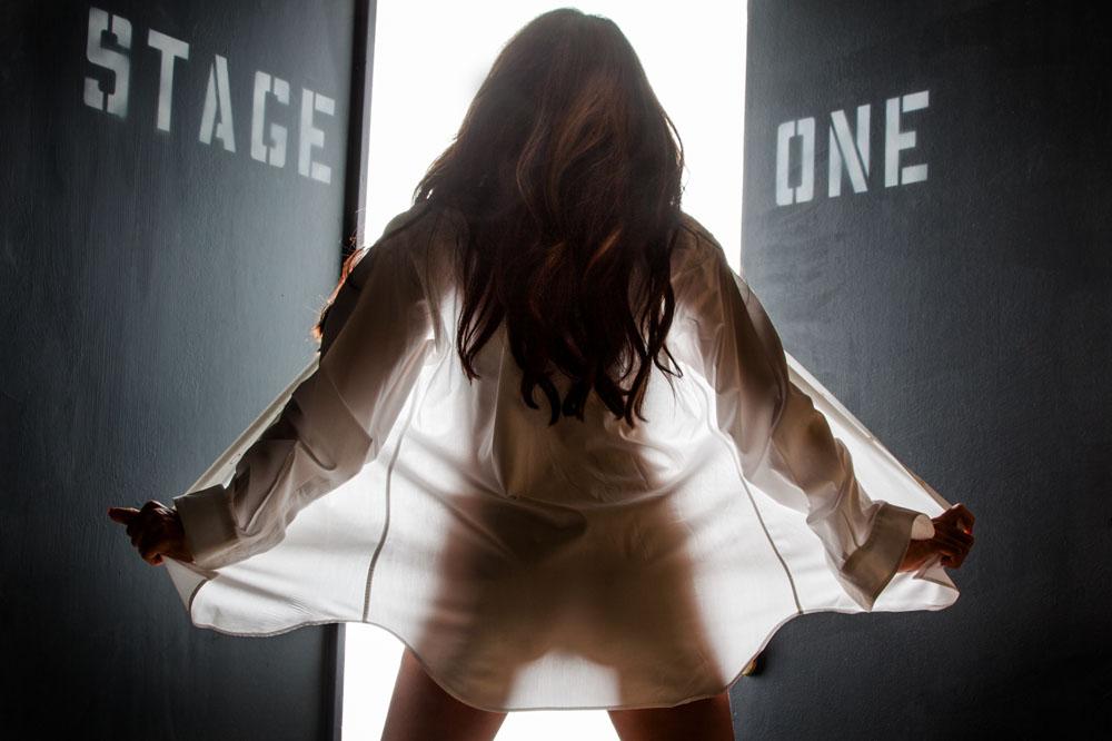 nude girl flashes in boudoir photo